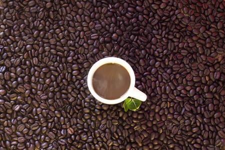 Coffee cup on beans background Reklamní fotografie
