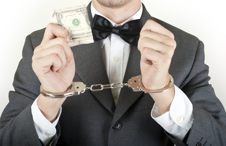 manager with money and handcuff isolated on white background Stock Photo - 10811398