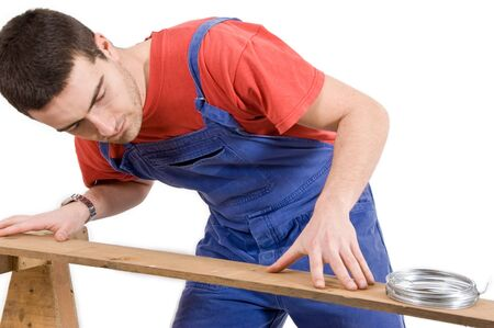 carpenter working on a wooden board Stock Photo - 12897473