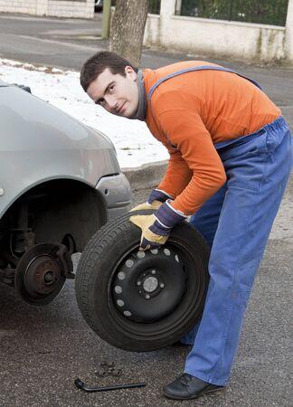 repairer: tire repairer changing a car  flat