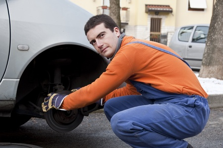 mechanic checking car brakes Stock Photo