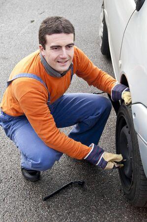 repairer: tire repairer changing a flat