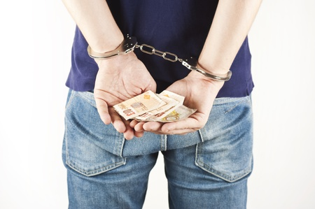 criminal prisoner with handcuffs and bills in his hands photo