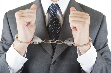 corruptible: manager whit handcuff isolated on white background Stock Photo