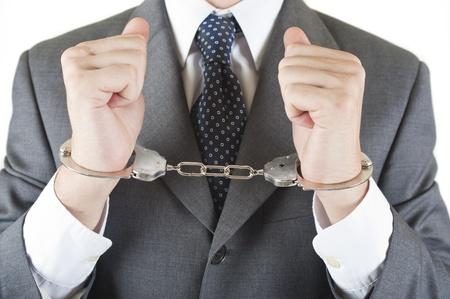 Manager Whit Handschellen isoliert auf weißem Hintergrund