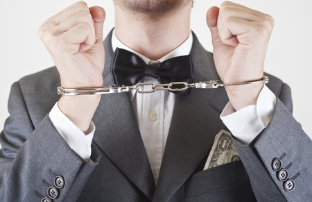 well dressed arrested manager Stock Photo - 10811400