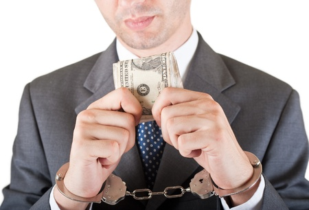 greedy manager with cash and handcuffs  photo