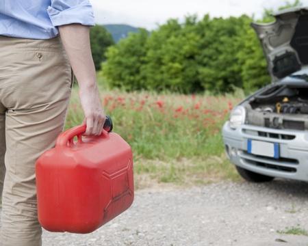 man handling a fuel tank