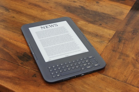kindle: ebook reading device on the table Stock Photo