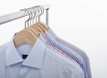 garderobe: front view of shirts and hanger isolated on white background