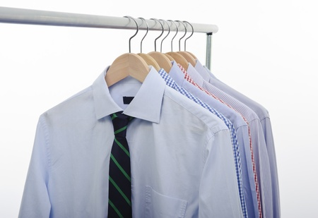 garderobe: hanger with shirts and necktie isolated on white backgrund