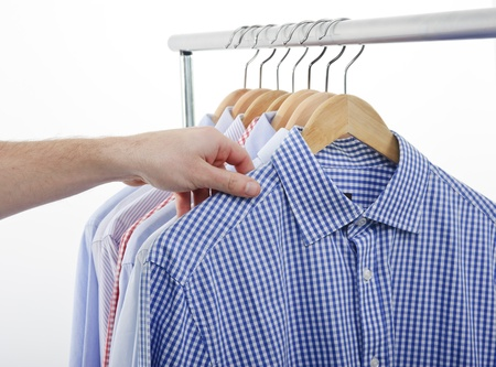 garderobe: man choosing and taking his shirt Stock Photo