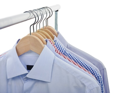 front view of shirts and hanger isolated on white background photo