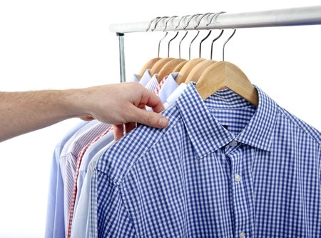 clothing rack: man choosing and taking his shirt isolated on white background