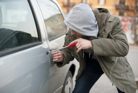 thieves: car thief in action Stock Photo