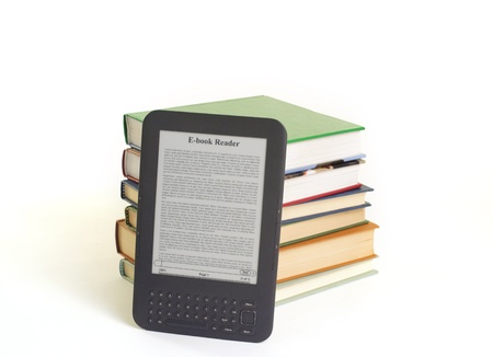 ebook reader and books isolated on ewhite background photo