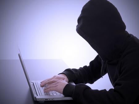 bad hacker working on an internet crime photo