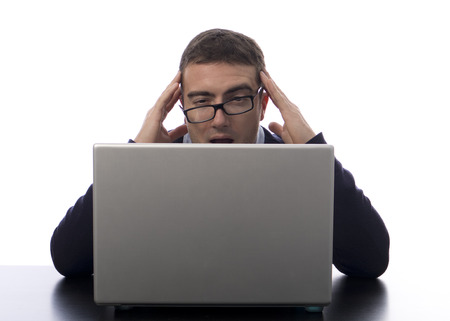 stressed worker reading bad news on his laptop