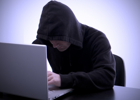 hacker writing on a laptop and data safety photo
