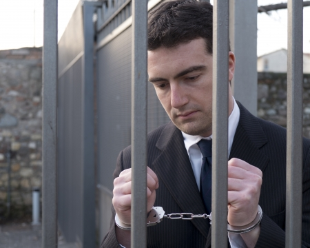 venal: corrupted manager going in jail with handcuffs Stock Photo