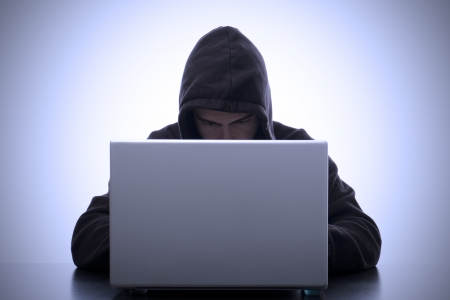 portrait of hacker and laptop meaning safety data Stock Photo