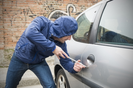 scammer: thief stealing automobile car  in the city street Stock Photo