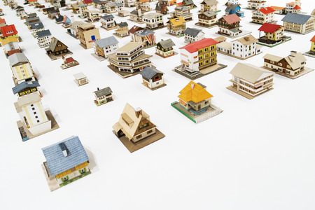 house business sales metaphor with house toys scale model