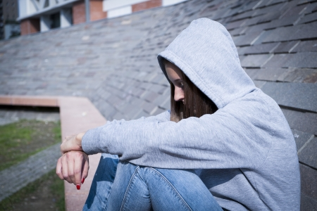 portrait of a sad and lonely young girl Stock Photo