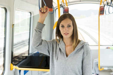 young girl on the public transport photo