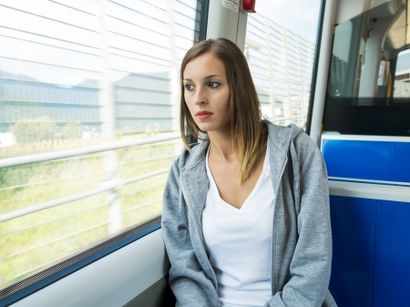 young girl seated on the public transport Stock Photo