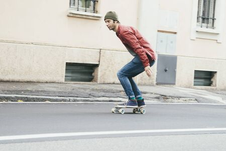 panning: man riding on a skate in the city street , movement effect panning Stock Photo