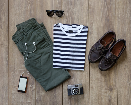 hipster casual clothes and accessories on a wooden background Foto de archivo