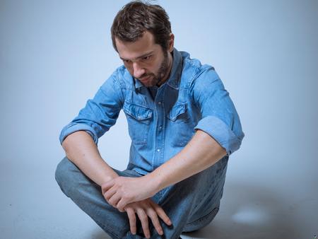 disappoint: Depressed man studio shot Stock Photo