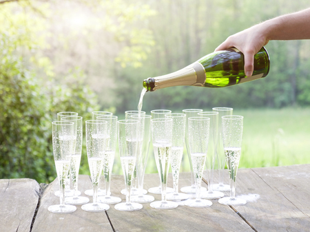 Pour champagne during sunset Stock Photo