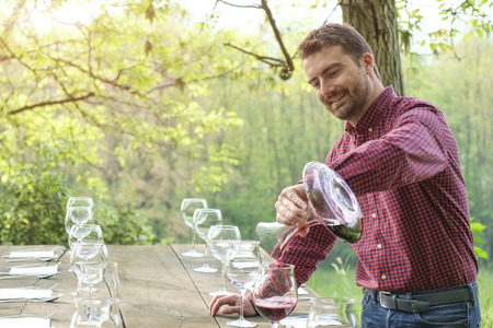knowledgeable: Man pour red wine Stock Photo