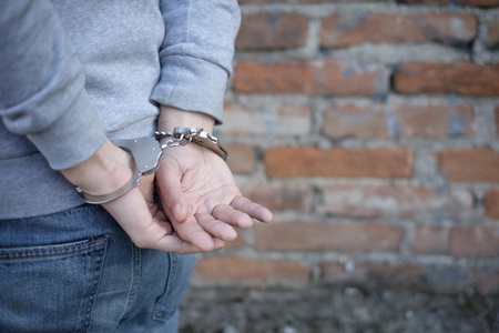 arrested: man arrested in handcuffs