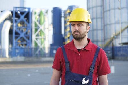 laborer: laborer outside a factory working dressed with safety overalls equipment Stock Photo