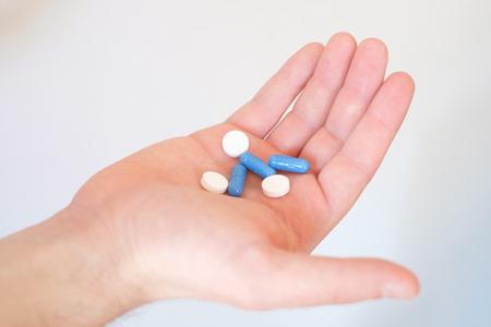 A hand full of medicines pills