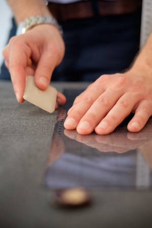 made to measure: Tailor hands measuring a piece of fabric , shallow depth of field focus Stock Photo
