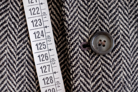 tailor tape: Tailor tape measure and fabric close-up detail Stock Photo