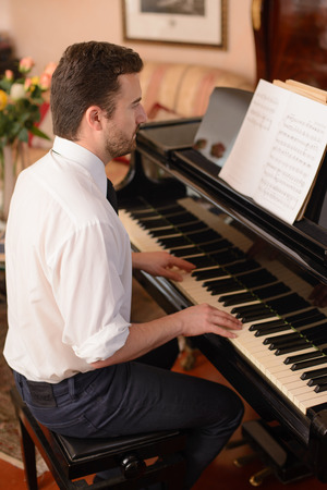 clavier: Portrait of music performer playing his piano Stock Photo