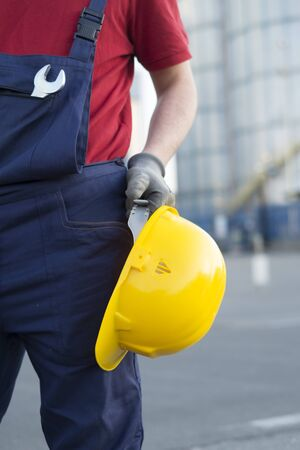 isolators: laborer outside a factory working dressed with safety overalls equipment Stock Photo