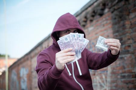 trafficking: Pusher selling and trafficking drug dose for money cash