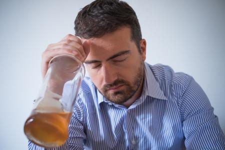 bad feeling: Man alcohol addicted feeling bad Stock Photo