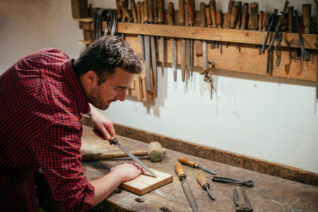 carpenter vise: Carpenter working with tools in his carpentry Stock Photo