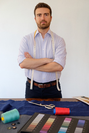 tailored: Tailor man working in his tailor shop