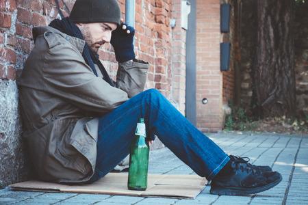 vagabond: Homeless lying on the street sidewalk alone Stock Photo