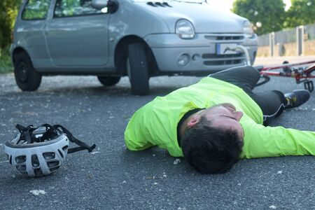 fainted: fainted aching man after bicycle accident on the asphalt