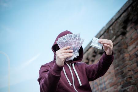 drug trafficking: Pusher selling and trafficking drug dose for money cash