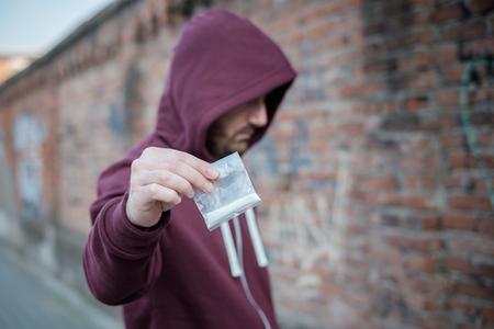 methamphetamine: Pusher selling and trafficking drug dose Stock Photo